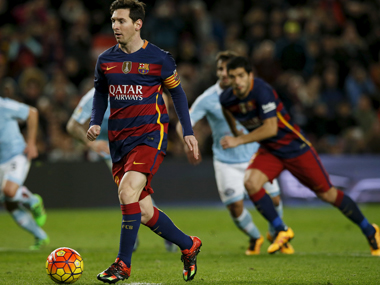 Messi combines with Suarez to score the penalty against Celta Vigo at Camp Nou on Sunday. Reuters