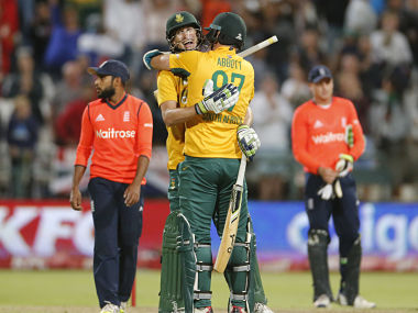 South African Kyle Abbott, front, celebrates with Chris Morris as South Africa clinch the first T20I in last ball thriller. AP