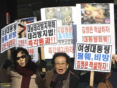 North Korean defectors shout slogans during a rally to denounce North Korea's criticism of South Korean President Park Geun-hye in Seoul. AP