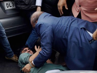 BJP MLA OP Sharma assaulting a CPI(M) activist in New Delhi on Monday. PTI