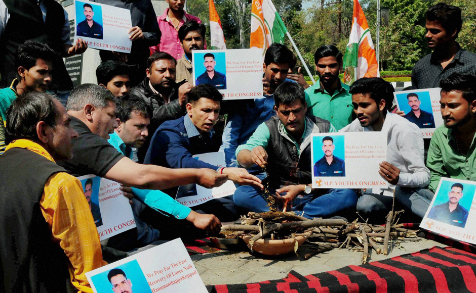 Bhopal: Youth Congress workers performing hawan for speedy recovery of Siachen miracle soldier Lance Naik Hanumanthappa Koppad, in Bhopal on Wednesday.PTI Photo