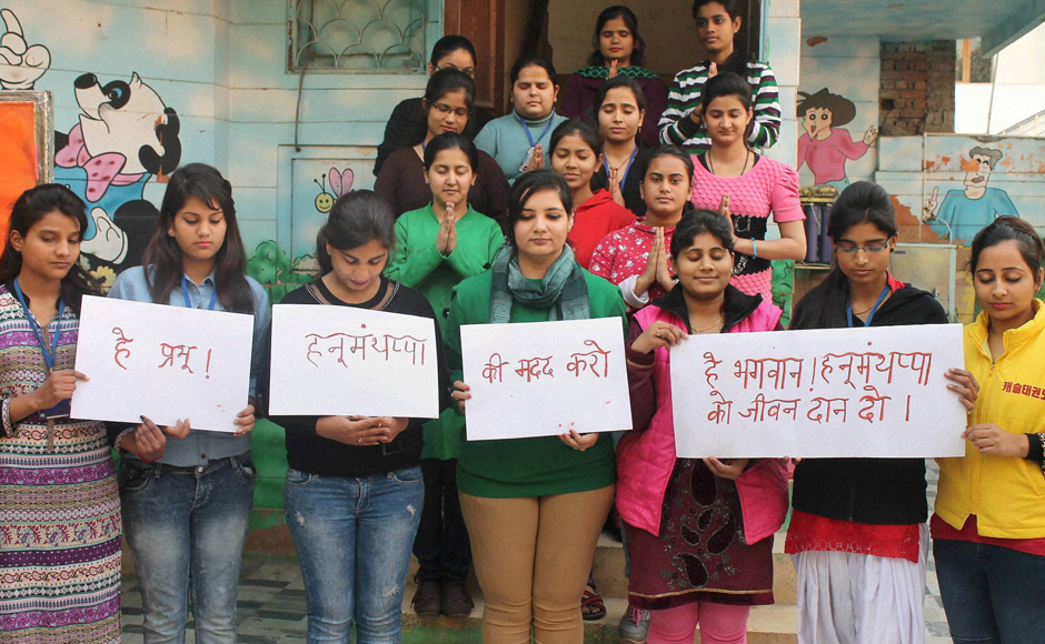 Faridabad: Students of Khazani Women's Vocational Institute pray for army man Hanumanthappa Koppad in Faridabad on Wednesday. Hanumanthappa was miraculously found alive after remaining under a huge mass of snow for six days at Siachen Glacier. PTI Photo