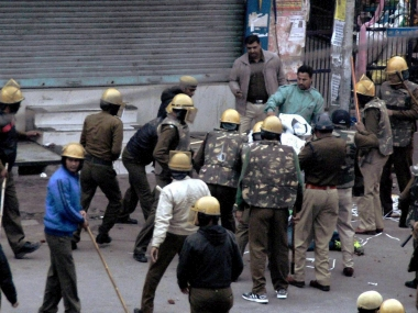 File image of cops lathi charging members of the Jat community during their agitation for reservation in Rohtak. PTI