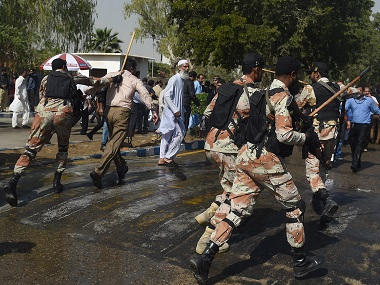 Pakistani paramilitary soldiers baton charge on employees of Pakistan International Airlines (PIA) during a protest near Karachi International Airport. AFP