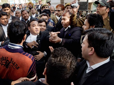 Lawyers clash among themselves at Patiala House Courts on Wednesday. PTI