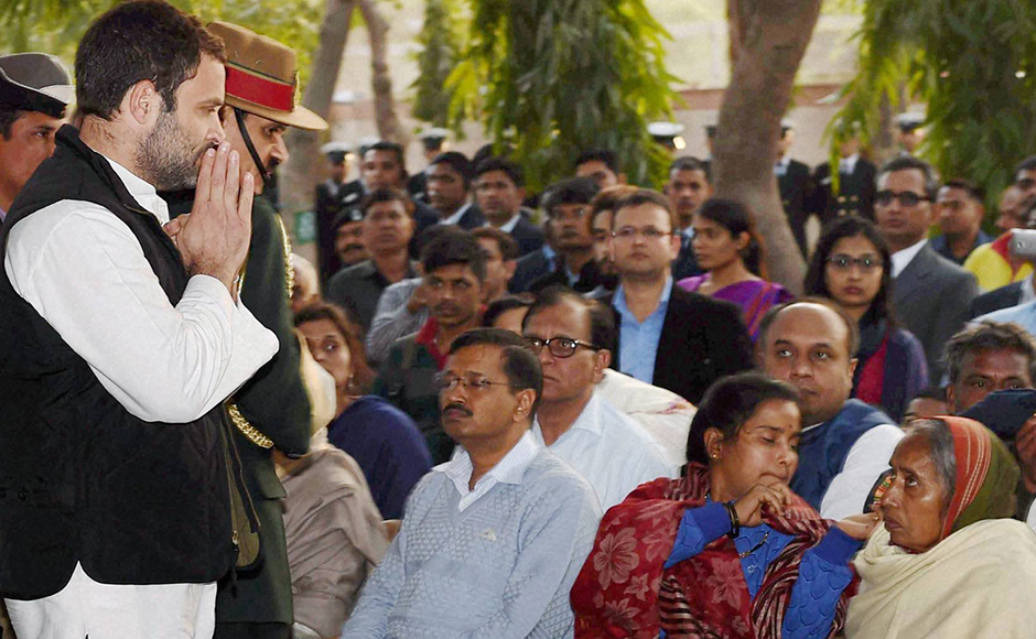 Congress Vice President Rahul Gandhi and Delhi CM Arvind Kejriwal with mother and wife of Lance Naik Hanumanthappa Koppad in Brar square, New Delhi on Thursday. Koppad was miraculously found alive after remaining buried under huge mass of snow for six days at Siachen Glacier, died in New Delhi on Thursday. PTI Photo by Manvender Vashist
