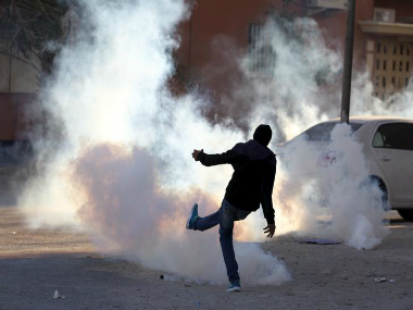 A protester in an anti-government clash in Sitra, 2011. REUTERS