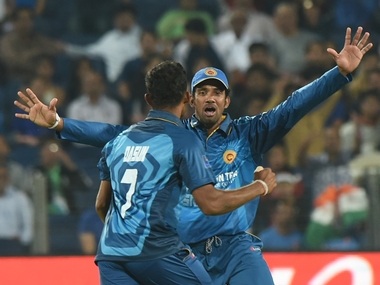 Sri Lanka's Dasun Shanaka (L)celebrates with teammate Sachithra Senanayake after taking the wicket of India's MS Dhoni in Pune T20I. AFP