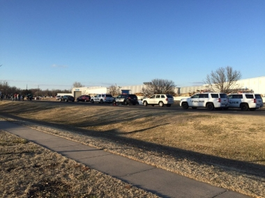 Police vehicles line the road after reports of a shooting in Hesston, Kansas. AP