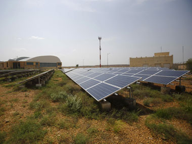 Solar panels are seen inside the premises of the Jaisalmer Airport in Rajasthan. Reuters