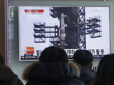 South Koreans watch a TV news program with a file footage about North Korea's rocket launch plans, at Seoul Railway Station in Seoul. AP