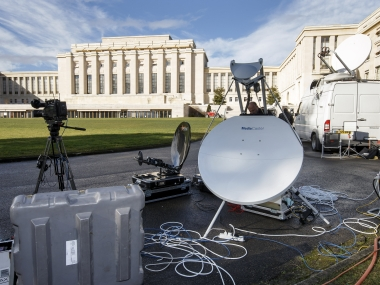 A technician sets up his TV equipment in front the UN building after Syria talks were rescheduled. AP