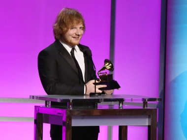 "Ed Sheeran accepts the award for best pop solo performance for ""Thinking Out Loud"" at the 58th annual Grammy Awards. AP"