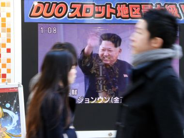 North Korea's leader Kim Jong-Un and a report on North Korea's rocket launch on Sunday. AFP