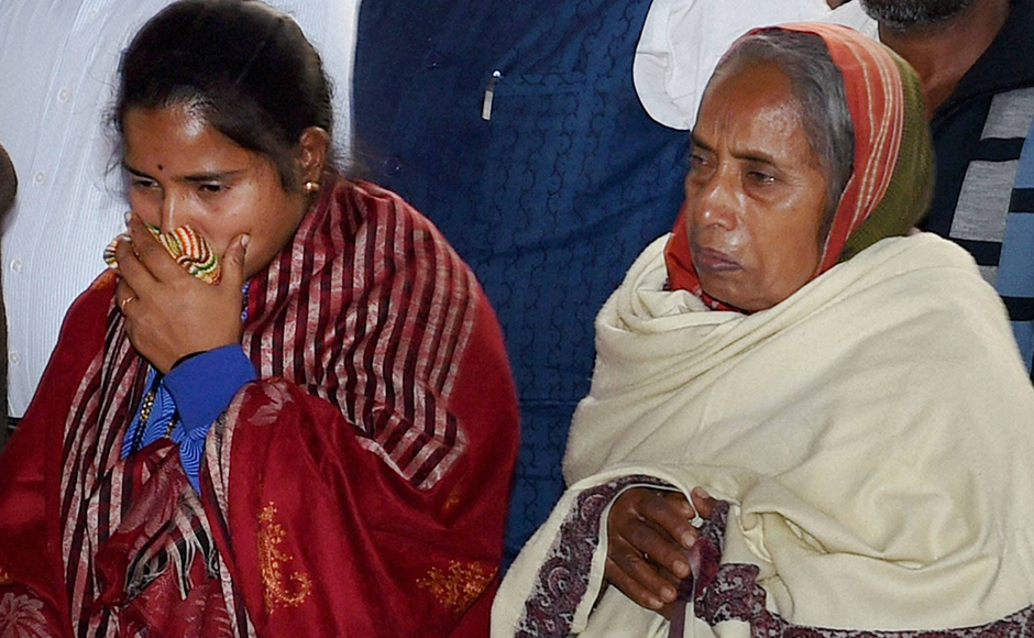 Lance Naik Hanumanthappa Koppad's wife Mahadevi and mother at Brar square in New Delhi on Thursday. Koppad was miraculously found alive after remaining buried under huge mass of snow for six days at Siachen Glacier, died in New Delhi on Thursday. PTI Photo by Manvender Vashist