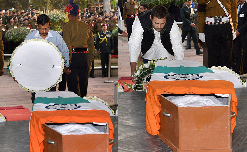 Delhi Chief Minister Arvind Kejriwal and Congress Vice President Rahul Gandhi pay their tributes to Lance Naik Hanumanthappa Koppad at Brar square in New Delhi on Thursday. Koppad was miraculously found alive after remaining buried under huge mass of snow for six days at Siachen Glacier, died in New Delhi on Thursday. PTI Photo by Manvender Vashist