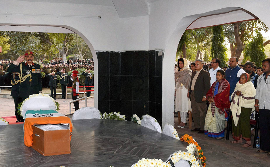 Army chief Gen Dalbir Singh pays his tributes to Lance Naik Hanumanthappa Koppad in Brar square, New Delhi on Thursday. Koppad was miraculously found alive after remaining buried under huge mass of snow for six days at Siachen Glacier, died in New Delhi on Thursday. PTI Photo by Manvender Vashist