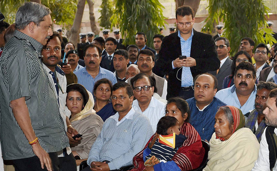 Defence Minister Manohar Parrikar and Congress Vice President Rahul Gandhi talk to mother and wife of Lance Naik Hanumanthappa Koppad in Brar square, New Delhi on Thursday. Koppad was miraculously found alive after remaining buried under huge mass of snow for six days at Siachen Glacier, died in New Delhi on Thursday. PTI Photo by Manvender Vashist