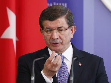 Prime Minister Ahmet Davutoglu said a Russian missile had hit the buildings and that many civilians including children had been killed. Reuters