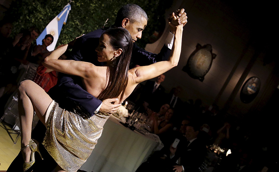 U.S. President Barack Obama dances tango during a state dinner hosted by Argentina's President Mauricio Macri at the Centro Cultural Kirchner as part of President Obama's two-day visit to Argentina, in Buenos Aires March 23, 2016. REUTERS/Carlos Barria - RTSBZHY