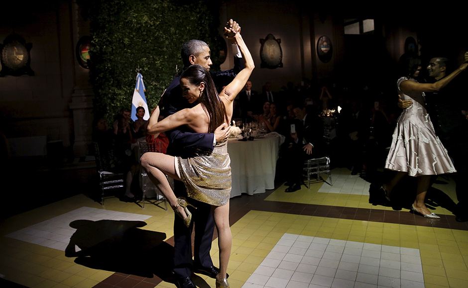 U.S. President Barack Obama dances tango during a state dinner hosted by Argentina's President Mauricio Macri at the Centro Cultural Kirchner as part of President Obama's two-day visit to Argentina, in Buenos Aires March 23, 2016. REUTERS/Carlos Barria - RTSBZI8