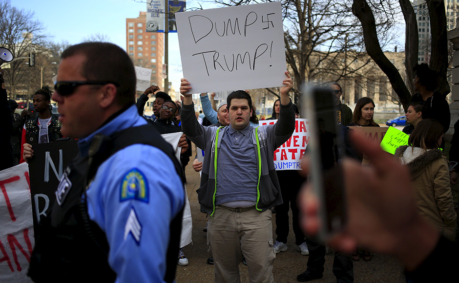 Protesters against U.S. Republican presidential candidate Donald Trump rally ahead of his speech at the Peabody Opera House, in St. Louis, Missouri March 11, 2016. REUTERS