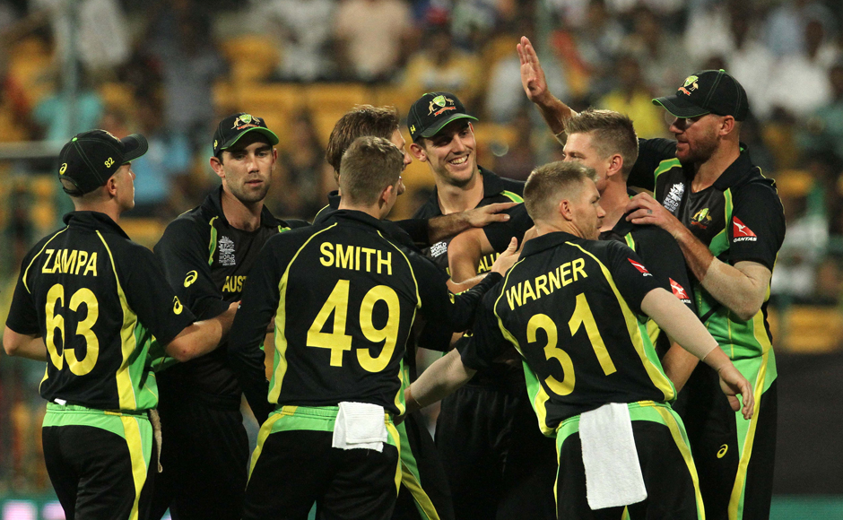 Australia players celebrate the wicket of Sabbir Rahman. Solaris Images