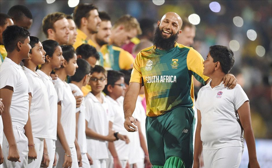 Hasim Amla shares a cheerful moment with a young macot before the national anthems. PTI