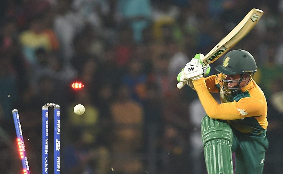De Kock castled! South African batsman watches the ball knock his leg stump off in the WT20 game against West India. AP