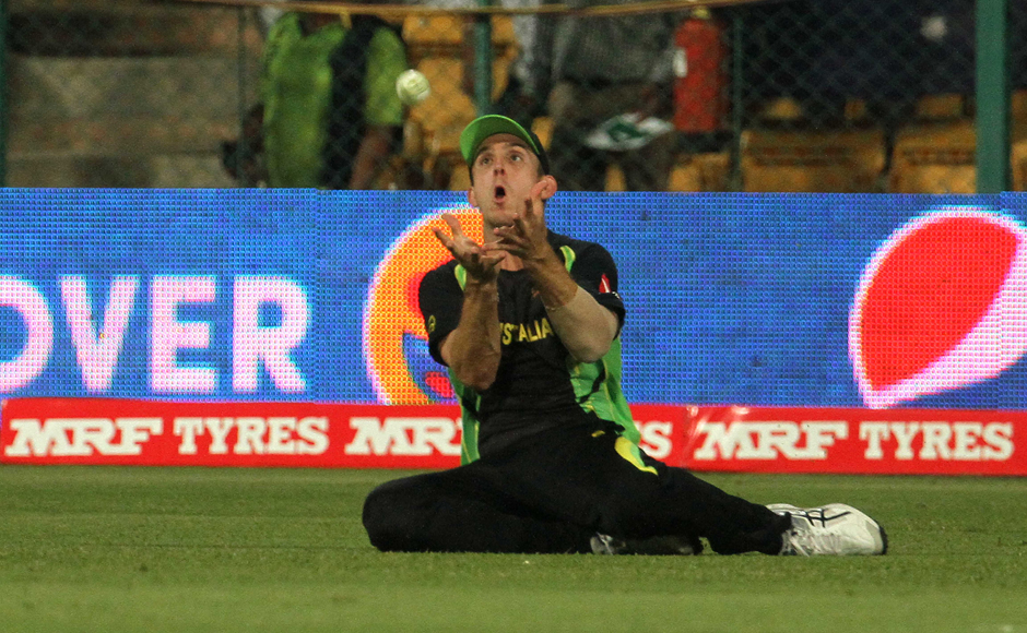 Mitchell Marsh (above) spills a catch of Shuvagata Hom. Solaris Images