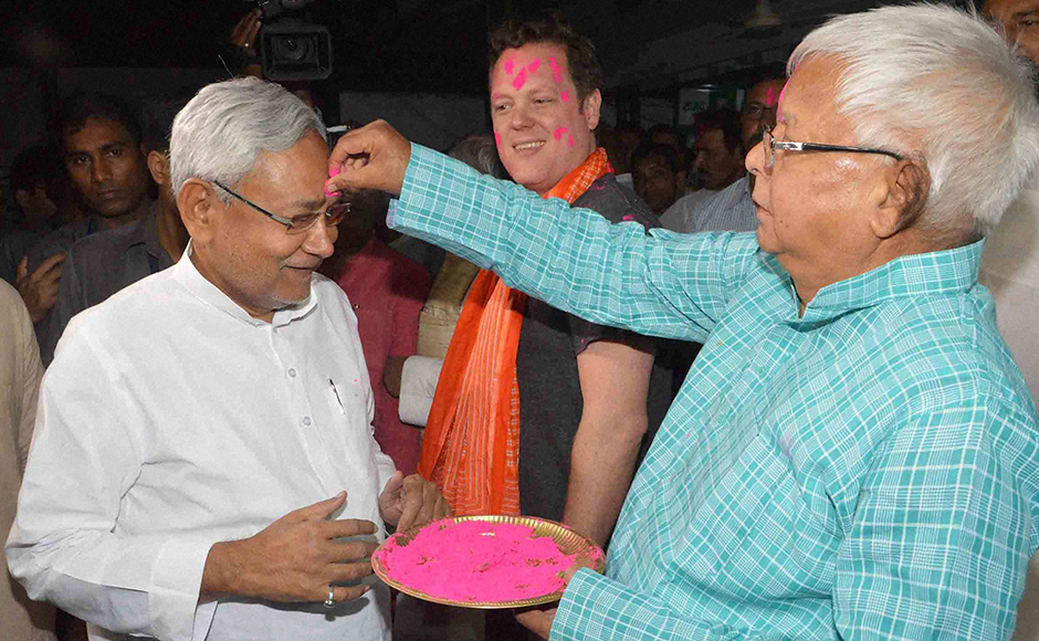 RJD Chief Lalu Prasad putting gulal to Bihar Chief Minister Nitish Kumar during Holi festival in Patna on Wednesday. PTI Photo