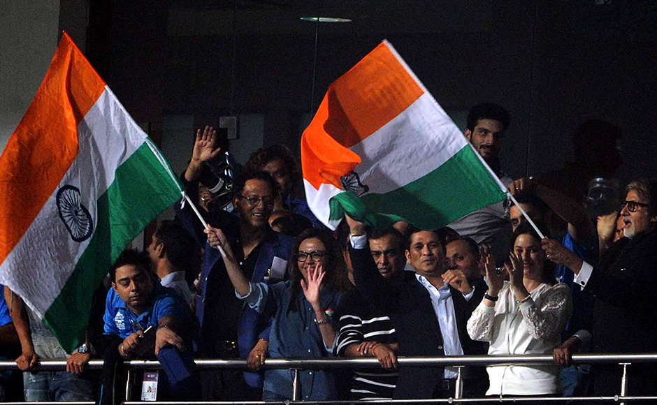 Mukesh Ambani, CMD, Reliance Industries Ltd, with wife Nita Ambani, Former Indian cricket player Sachin Tendulkar and his wife Anjali Tendulkar, Bollywood actors Amitabh Bachchan and Abhishek Bachchan waving the tricolour after winning the ICC Twenty20 World Cup match against Pakistan at the Eden Garden Stadium in Kolkata, India on March 19, 2016. Getty Images
