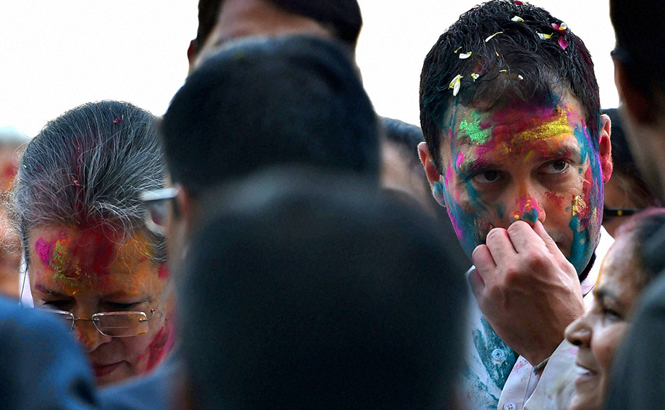 Congress President Sonia Gandhi and her son and party's Vice President Rahul Gandhi celebrate Holi with party workers at All India Congress Committee headquarters (AICC) in New Delhi on Thursday. PTI Photo