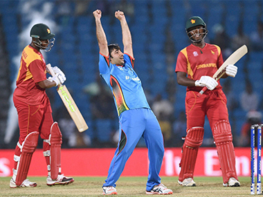 Asghar Stanikzai celebrates Afghanistan's victory against Zimbabwe in the World T20 qualifier in Nagpur on Saturday. PTI-AP