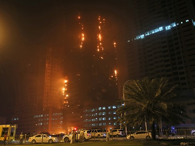 Fire and smoke billow from a high-rise building in Ajman, United Arab Emirates, early Tuesday. AP