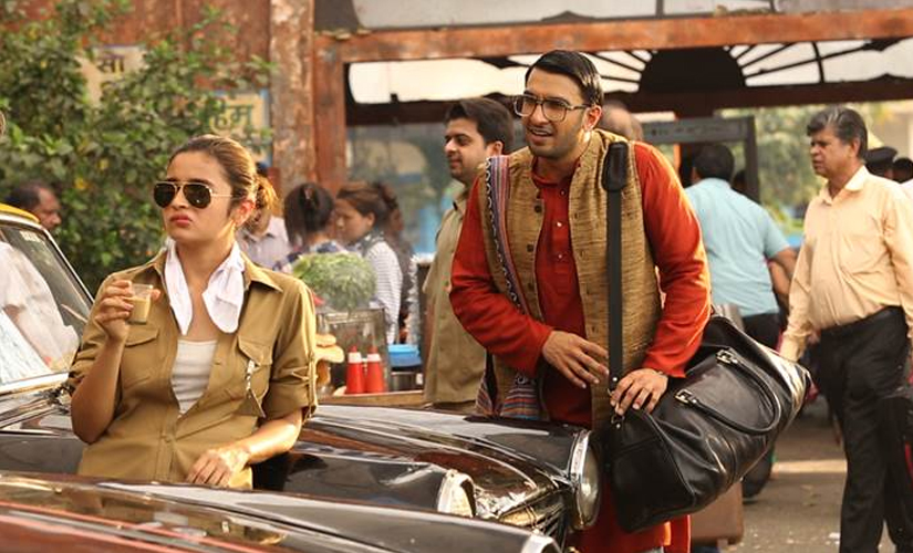 Alia depicts a taxi driver and Ranveer her passenger in the first photo