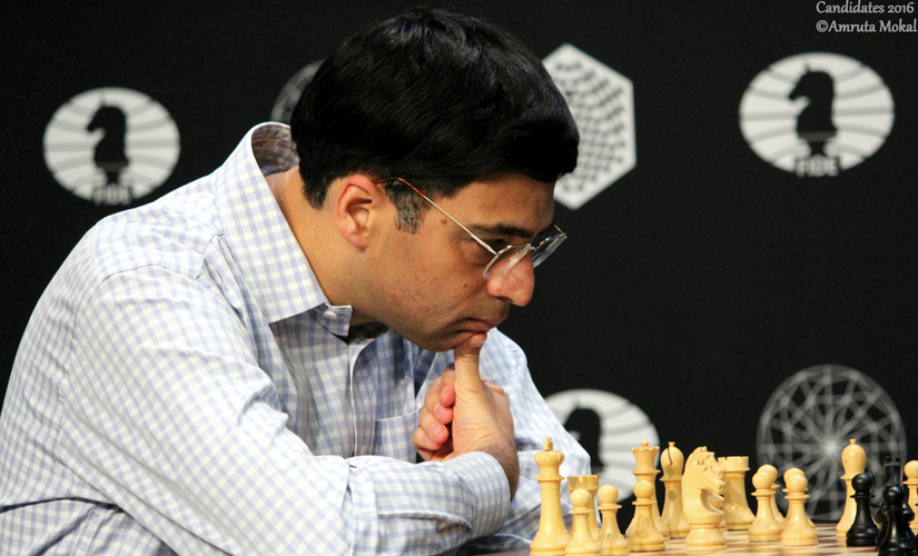 Anand, who played with white pieces, ponders a move against Aronian. Amruta Mokal