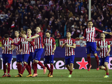 Atletico Madrid players celebrate their win over PSV Eindhoven in the Champions League second-leg match at Vicente Calderon in Madrid on Tuesday. AFP