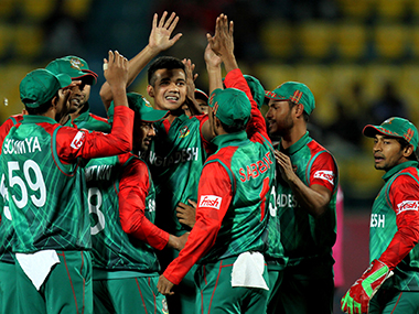 Bangladesh players celebrate their win over Oman in the World T20 match in Dharamsala on Sunday. AFP