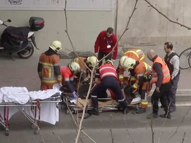 Emergency rescue workers stretcher an unidentified person at the site of an explosion at a metro station in Brussels in a file photo. APTN via AP