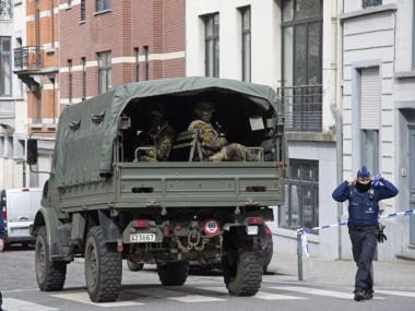 A truck carrying soldiers of the Belgian Army arrives after a explosion in a main metro station in Brussels on Tuesday. AP