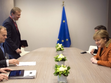 German Chancellor Angela Merkel meets with European Council President Donald Tusk on the sidelines of an EU summit in Brussels. AP