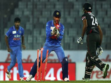 Dhoni in action against UAE. PTI