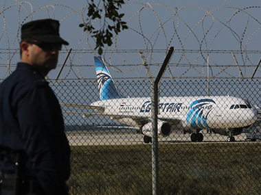 A police personnel stands guard at the Cyprus airport. Reuters