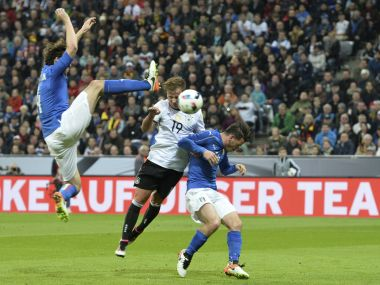 Germany''s Mario Goetze scores his side's second goal during a friendly match against Italy. AP