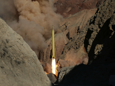 """Iran's powerful Revolutionary Guard test-fired two ballistic missiles Wednesday with the phrase """"Israel must be wiped out"""" written on them, a show of deterrence power by the Islamic Republic as US Vice President Joe Biden visited Israel, Fars news agency reported. (AP Photo/Fars News Agency)"""