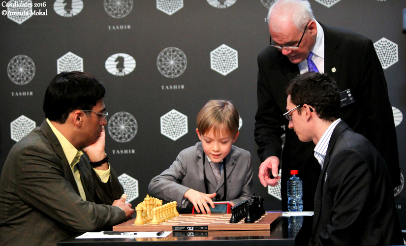 A 9-year-old Russian kid inaugurates the round between Anand and Caruana by starting the clock. Amruta Mokal