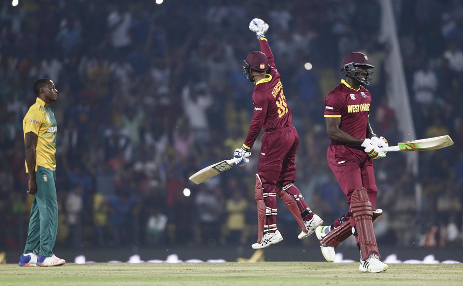 Semi-finals Calling: West Indies' Dinesh Ramdin jumps in joy after win over South Africa. AP