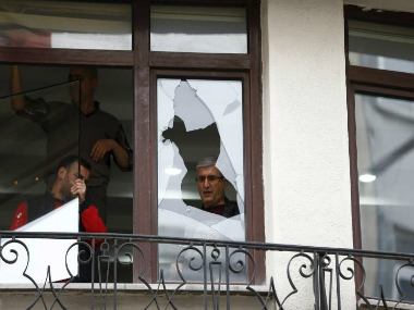 Workers remove glass from the broken window next to the scene of a suicide bombing at Istiklal street, a major shopping and tourist district, in central Istanbul. REUTERS
