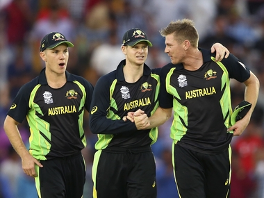 Adam Zampa, Steve Smith and James Faulkner of Australia celebrate victory against Pakistan. Getty